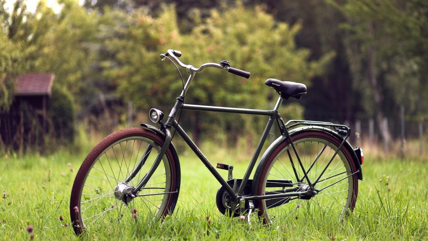 http://on-desktop.com/wps/Creative_Wallpaper_Bicycle_on_the_grass_079830_.jpg
